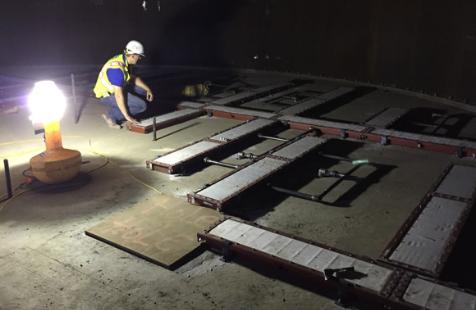 Man laying down air pad diffusers, air stones, and air slides