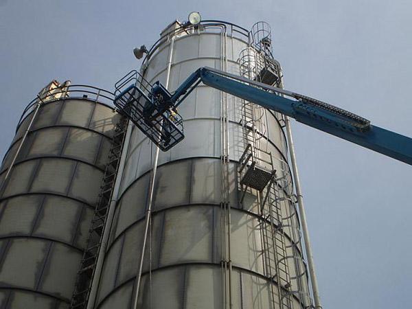 Man performing silo coating
